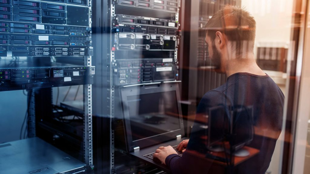 PEDataCenter team working on a server